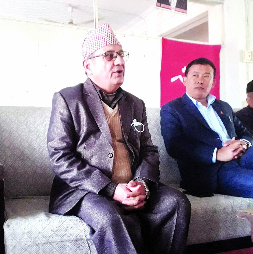 Nepal Communist Party (NCP) leader Bhim Acharya and his supporters speaking to mediapersons at the party office in Biratnagar, on Monday. Photo: THT