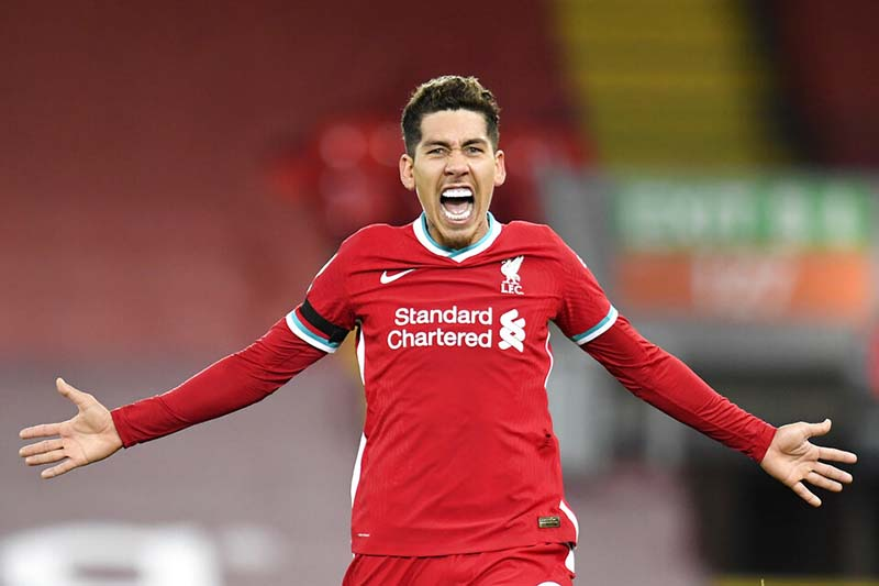 Liverpool's Roberto Firmino celebrates after scoruing his side's 2nd goal during their English Premier League soccer match between Liverpool and Tottenham Hotspur at Anfield in Liverpool, England, on Wednesday, December, 16, 2020. Photo: Peter Powell/ Pool via AP
