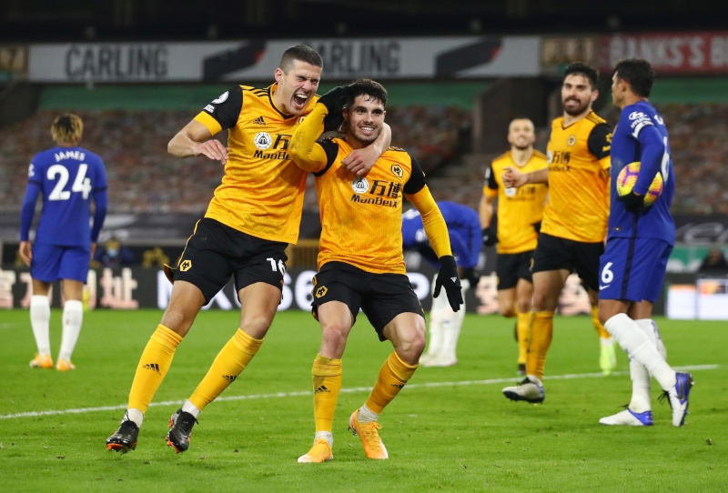 Wolverhampton Wanderers' Pedro Neto celebrates scoring their second goal with Conor Coady during the Premier League match between Wolverhampton Wanderers and Chelsea, at Molineux Stadium, in Wolverhampton, Britain, on December 15, 2020. Photo:  Pool via Reuters