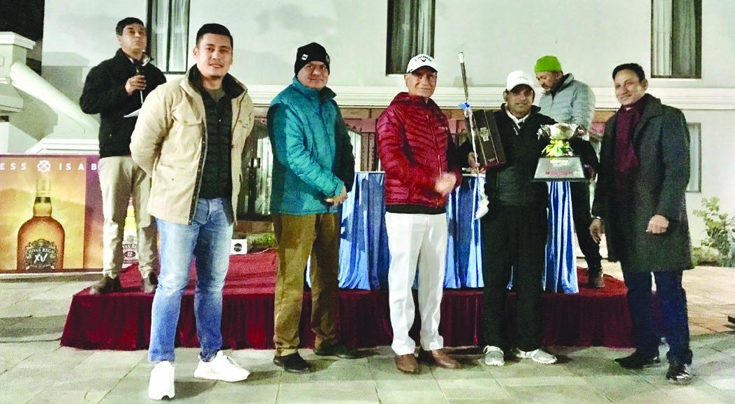 Rabindra Tiwari celebrates with the winneru2019s trophy after the Chivas Open Golf Tournament at the Gokarna Golf Club in Kathmandu on Saturday. Photo Courtesy: Gokarna Golf Club