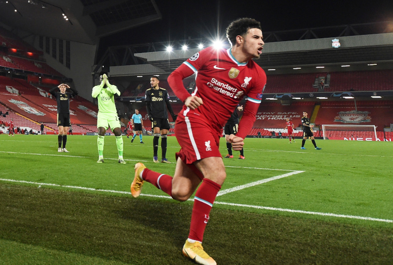 Liverpool's Curtis Jones celebrates scoring their first goal as Ajax's Andre Onana looks dejected during the Champions match between League Group D match between   Liverpool and Ajax Amsterdam, at Anfield, in Liverpool, Britain, on December 1, 2020. Photo:  Pool via Reuters