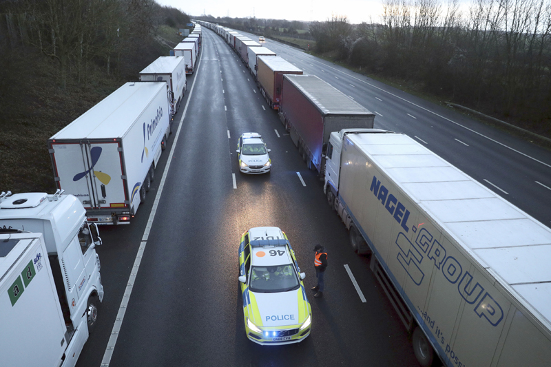 Police patrol along the M20 motorway where freight traffic is halted whilst the Port of Dover remains closed, in Ashford, Kent, England, Tuesday, Dec. 22, 2020. Photo: Andrew Matthews/PA via AP