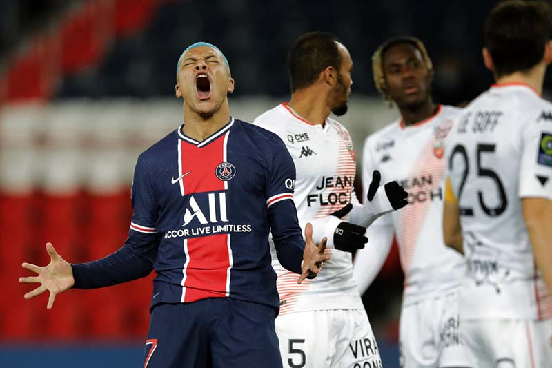 PSG's Kylian Mbappe reacts after missing a goal during the French League One soccer match between Paris Saint-Germain and Lorient at the Parc des Princes in Paris, France, on Wednesday, December 16, 2020. Photo: AP