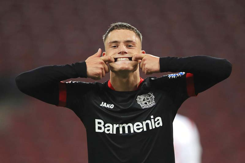 Leverkusen's Florian Wirtz celebrates his goal to make it 4:0 during the German Bundesliga soccer match between 1. FC Cologne and Bayer Leverkusen at the RheinEnergieStadion in Cologne, Germany, on Wednesday, December 16, 2020. Photo: Wolfgang Rattay/dpa via AP
