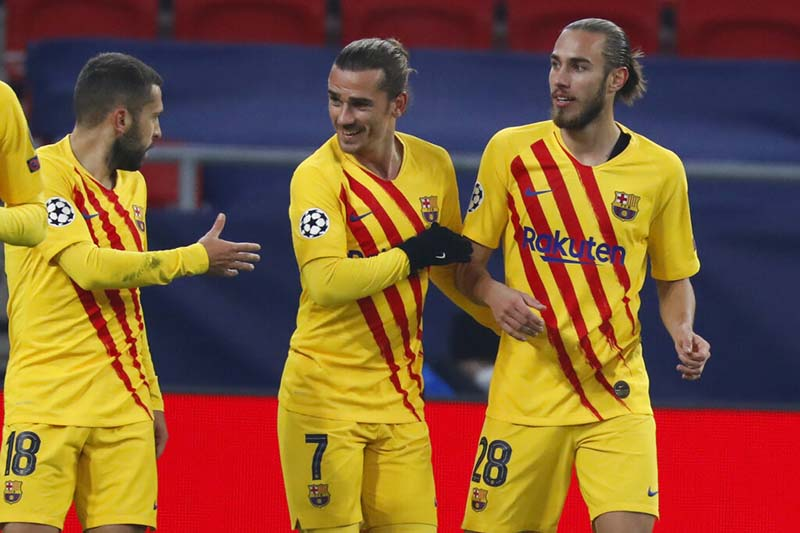 Barcelona's Antoine Griezmann (centre) celebrates after scoring his side's opening goal during the Champions League group G soccer match between Ferencvaros and Barcelona at the Ferenc Puskas stadium in Budapest, Hungary, on Wednesday, December 2, 2020. Photo: AP