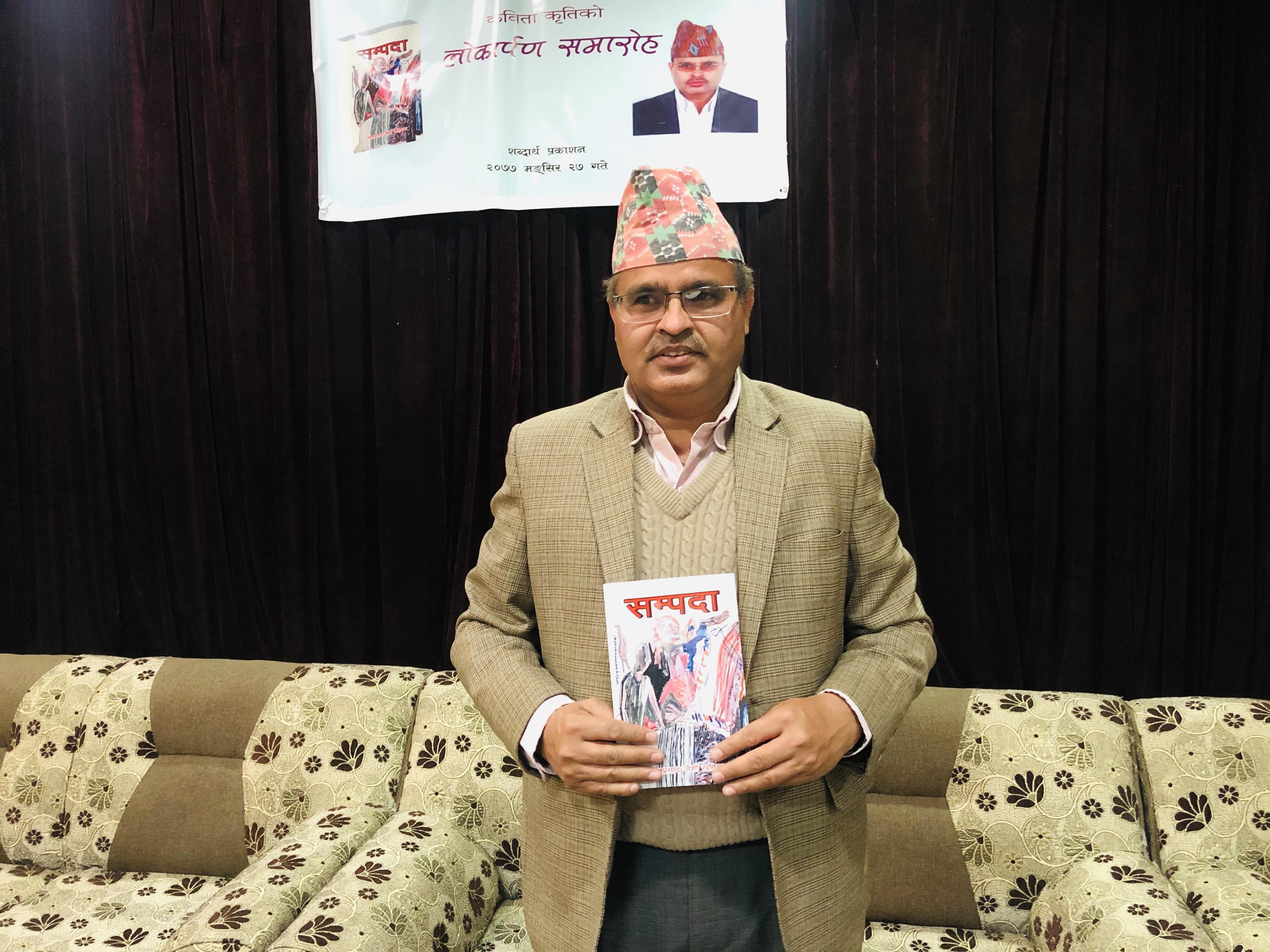 The author, Shivaprasad Jaisi Khatiwada, poses with his book. Photo: Mausam Shah Nepali/THT