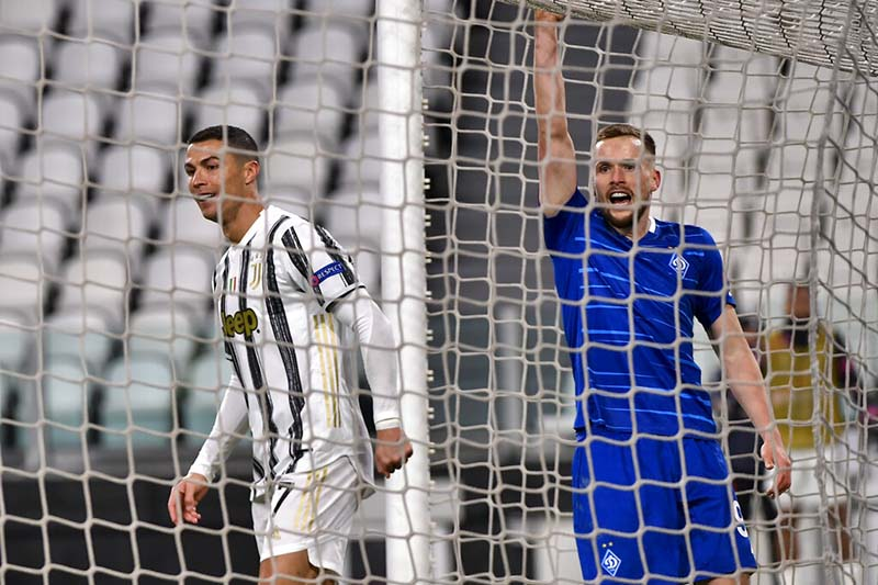 Cristiano Ronaldo of Juventus, left, celebrates a goal against Dynamo Kyiv during a Champions League, group G soccer match between Juventus and Dinamo Kyiv at the Allianz Stadium in Turin, Italy, on Wednesday, December 2, 2020. Photo: Marco Alpozzi/LaPresse via AP