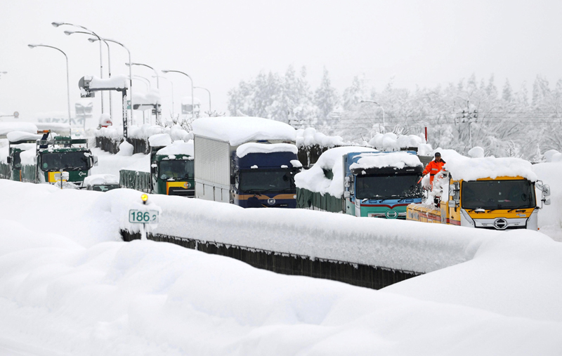 Vehicles are stranded on the snow-covered Kanetsu expressway in Minamiuonuma in Niigata Prefecture, Japan in this photo taken by Kyodo December 18, 2020  Photo: Kyodo/via Reuters