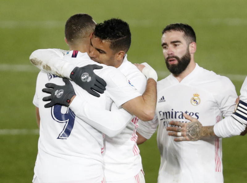 Real Madrid's Casemiro celebrates with Karim Benzema after the match during the  La Liga Santander match between Real Madrid and Granada, at Estadio Alfredo Di Stefano, in Madrid, Spain, on December 23, 2020. Photo:  Reuters