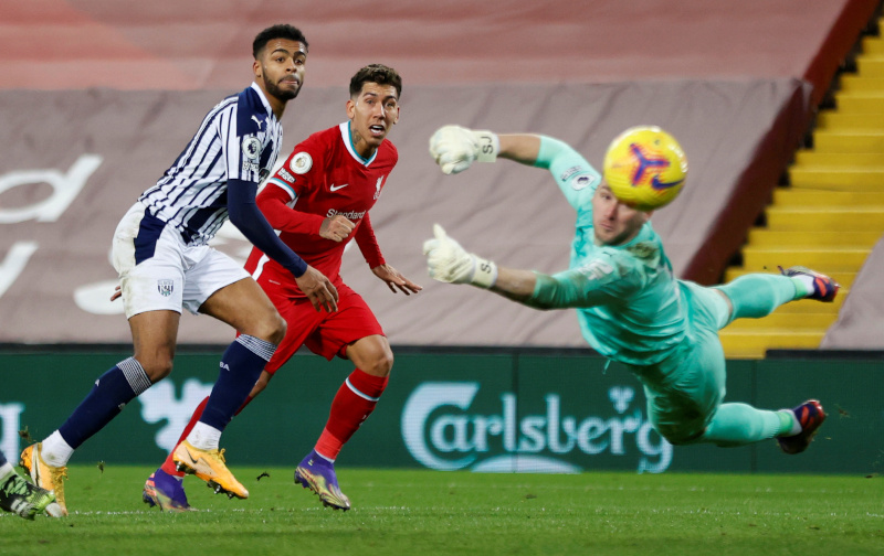 West Bromwich Albion's Sam Johnstone makes a save from Liverpool's Roberto Firmino during the Premier League match between Liverpool and West Bromwich Albion, at Anfield, in Liverpool, Britain, on December 27, 2020. Photo:  Pool via Reuters