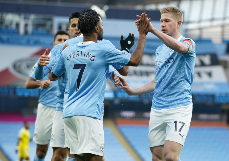 Manchester City's Raheem Sterling celebrates scoring their first goal with Kevin De Bruyne during the Premier League match between Manchester City and Fulham, at Etihad Stadium, in  Manchester, Britain, on December 5, 2020. Photo:  Pool via Reuters