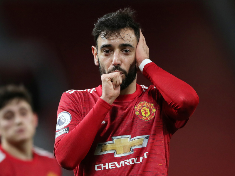 Manchester United's Bruno Fernandes celebrates scoring their third goal during the Premier League match between Manchester United and Leeds United, at Old Trafford, in  Manchester, Britain, on December 20, 2020. Photo: Pool via Reuters