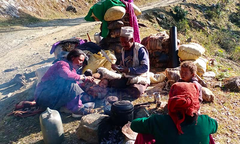 This undated image shows a migrating Bhote family taking rest by the roadside in Pandusain, Budhinanda Municipality-9 of Bajura district. The Bhote family migrated to Aula in Achham to escape the cold in the winter. Photo: Prakash Singh/THT
