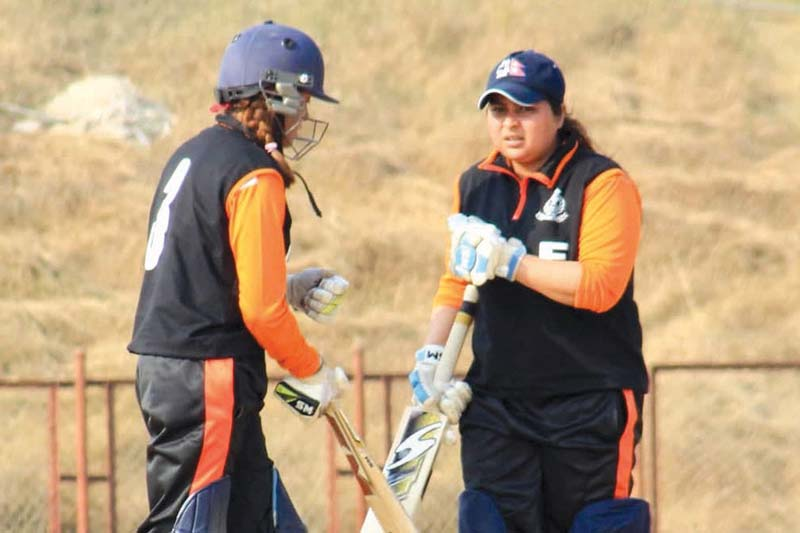 APFu2019s Jyoti Pandey (right) and Indu Barma celebrate during their Sagarmatha Cement PM Womenu2019s National Cricket League match against Lumbini Province in Dang on Monday, December 28, 2020. Photo: THT