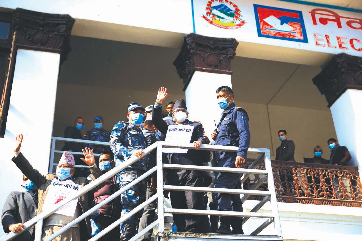 Nepal Communist Party (NCP) leaders Pushpa Kamal Dahal (right) and Madhav Kumar Nepal waving to their supporters from the building of Election Commission during a protest against the dissolution of the House of Representatives, in Kathmandu, on Friday, December 25, 2020. Photo: THT