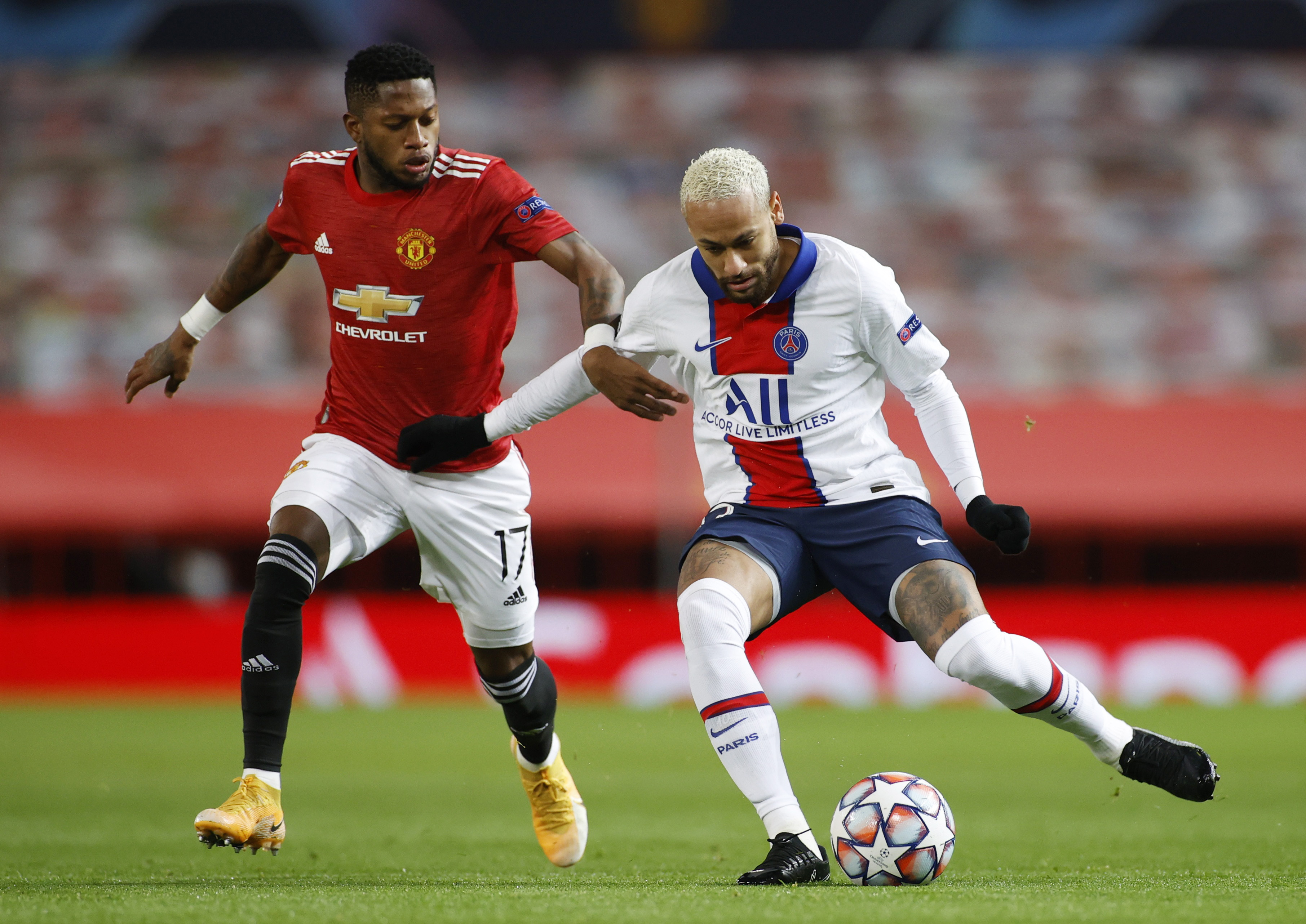 Manchester United's Fred in action with Paris St Germain's Neymar. Photo: Reuters