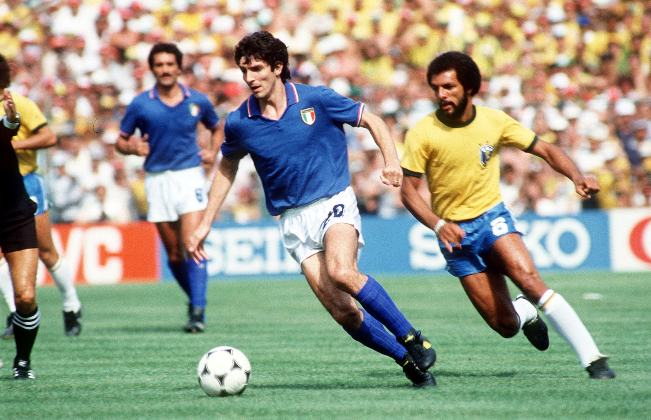 Italy's Paolo Rossi gets away from Brazil's Junior. Mandatory Credit: Action Images/File Photo