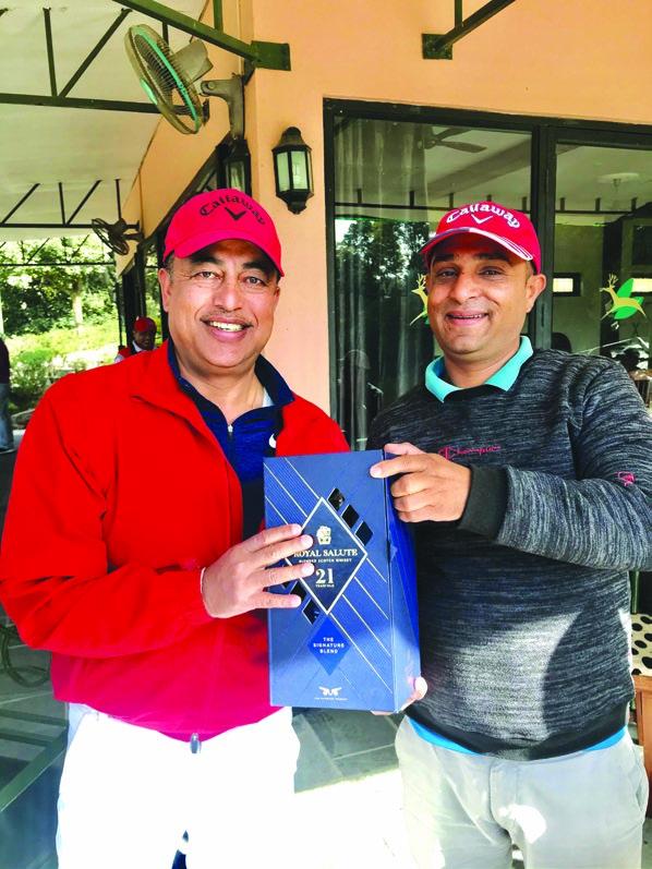 Pavitra Karki (left) receiving the winneru2019s prize from sponsor Atmaram Simkhada after the Social Golf Tournament at the Gokarna Golf Club in Kathmandu on Saturday.  n Photo Courtesy: Gokarna Golf Club