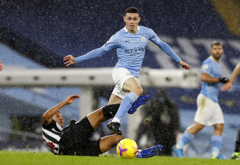 Manchester City's Phil Foden in action with Newcastle United's Isaac Hayden during the Premier League match between Manchester City and Newcastle United, at Etihad Stadium, in Manchester, Britain, on  December 26, 2020. Photo: Pool via Reuters