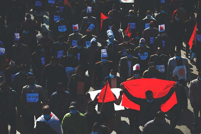 Hundreds of demonstrators led by former prime ministers Pushpa Kamal Dahal and Madhav Kumar Nepal took to the streets to protest against the dissolution of the House of Representatives, in Kathmandu, on Friday, December 25, 2020. Photo: Skanda Gautam / THT