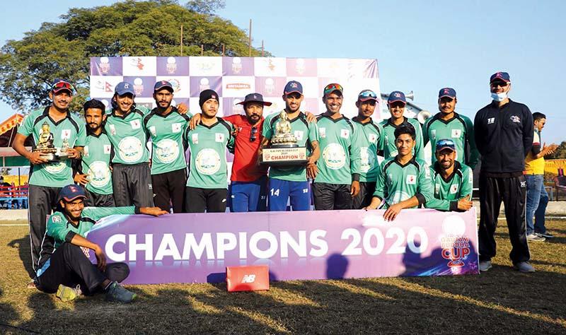Rapti team members celebrate with the trophy after winning the Gautam Buddha Cup at the under-construction Gautam Buddha International Stadium in Chitwan on Tuesday, December 15, 2020. Photo Courtesy: HamroKhelkud