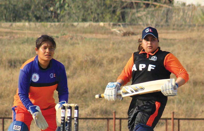 Nepal APF Clubu2019s Jyoti Pandey completes a run as Province-2 wicketkeeper Saraswati Kumari looks on during their Sagarmatha Cement PM Womenu2019s National Cricket League match in Dang on Sunday, December 27, 2020. Photo: THT