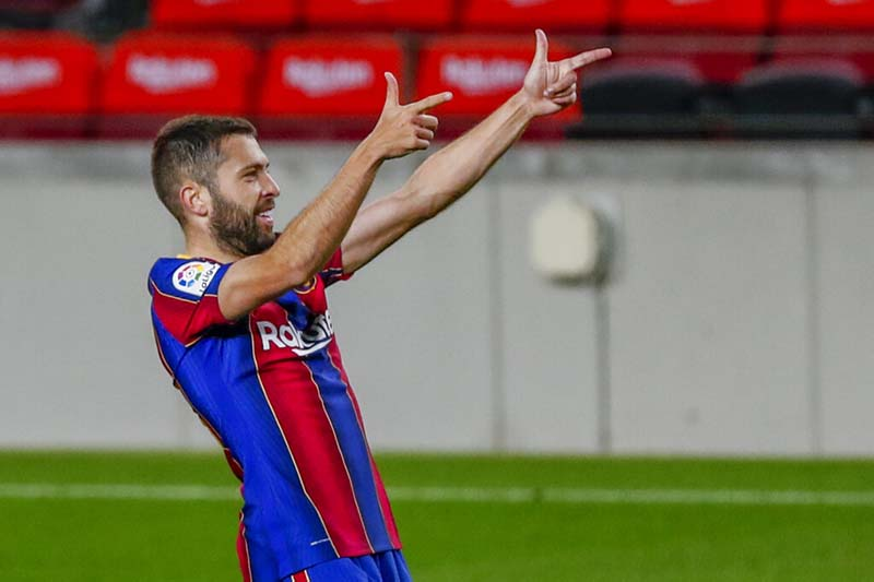 Barcelona's Jordi Alba celebrates after scoring his side's first goal during the Spanish La Liga soccer match between FC Barcelona and Real Sociedad at the Camp Nou stadium in Barcelona, Spain, on Wednesday, December 16, 2020. Photo: AP