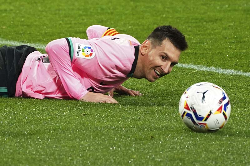 Barcelona's Lionel Messi lies on the ground during a Spanish La Liga soccer match between Valladolid and Barcelona at the Jose Zorrilla stadium in Valladolid, Spain,on Tuesday December 22, 2020. Photo: Cesar Manso/Pool via AP