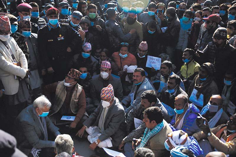 Senior leader of Nepali Congress, Ram Chandra Paudel, meeting sugarcane farmers who came to Kathmandu from Sarlahi district demanding that the government fulfil its commitment to make sugar mills clear the farmersu2019 dues, on Friday, December 18, 2020. Photo: Skanda Gautam/THT File
