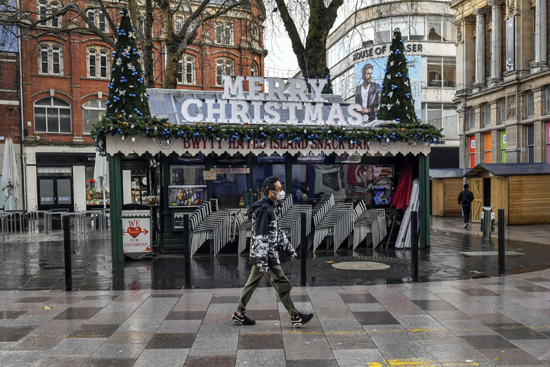 A person walks through Cardiff city centre, Sunday Dec. 20, 2020. In Wales, authorities said they decided to move up a lockdown planned for after Christmas and people must stay at home from 12:01 a.m. Sunday. Photo: Ben Birchall/PA via AP