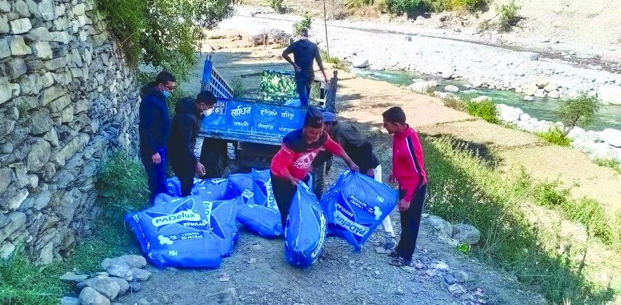 Workers transporting sanitary pads in tractors in Badimalika Municipality, Bajura, on Sunday. Photo: THT