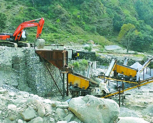 A crusher plant operating illegally near Bahulikhola River in Badimalika Municipality, Bajura, on Monday. Photo: THT