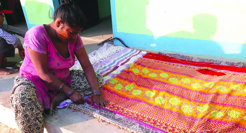 A woman preparing a quilt to survive the winter cold, in Bara, on Saturday. Photo: THT