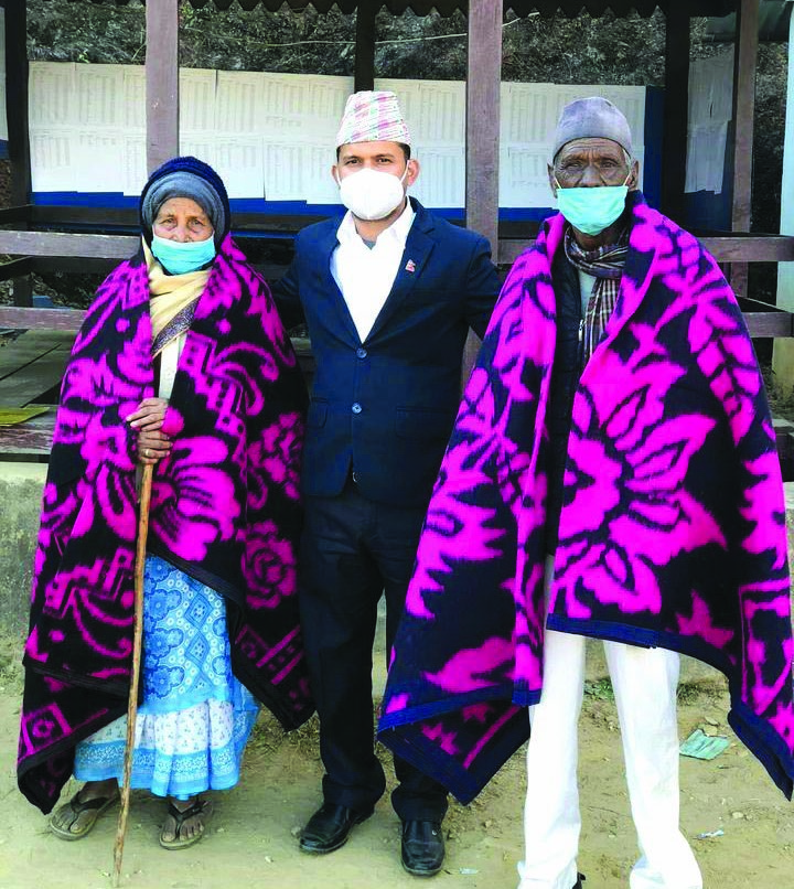 Elderly persons posing for a photo after receiving warm blankets from the district administration, in Achham, on Thursday. Photo: THT