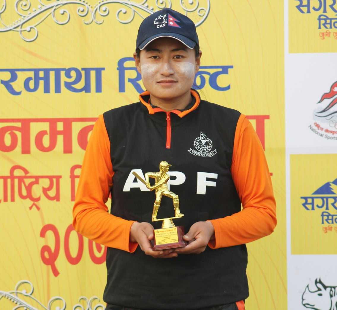 Nepal APF Club skipper Sita Rana Magar holds the player-of-the-match award after their victory over Karnali Province in the Sagarmatha Cement Prime Minister Cup Womenu2019s National Cricket Tournament in Dang on Saturday. Photo: THT