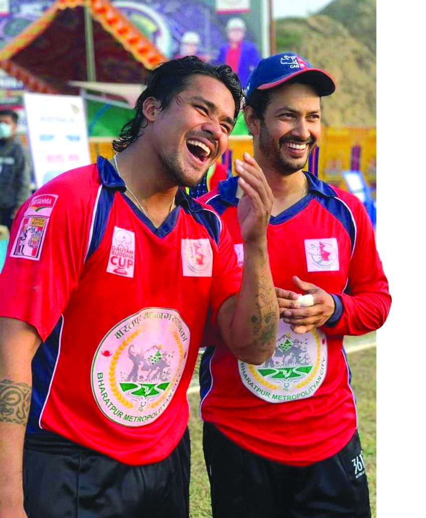 Narayaniu2019s Karan KC (left) celebrates with skipper Subash Khakurel after their victory over Bagmati in the Gautam Buddha Cup in Chitwan on Saturday. Photo: THT