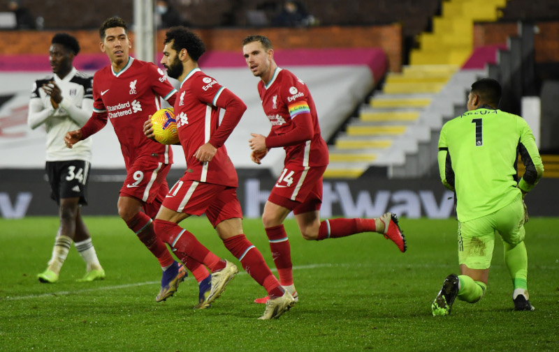 Liverpool's Mohamed Salah celebrates scoring their first goal during the Premier League match between Fulham and Liverpool, at Craven Cottage, in London, Britain, on December 13, 2020. Photo: Pool via Reuters