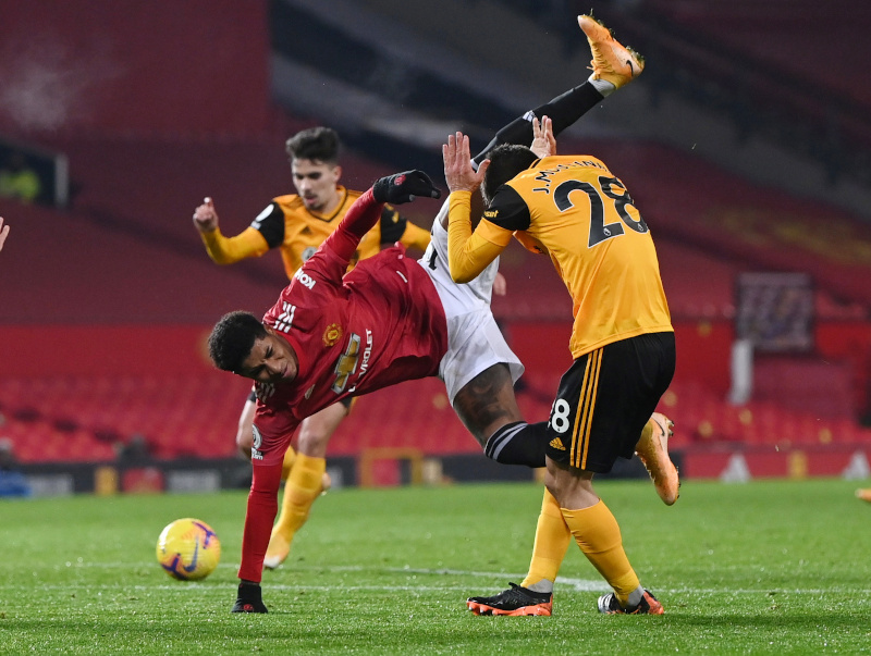Manchester United's Marcus Rashford in action with Wolverhampton Wanderers' Joao Moutinho during the Premier League match between Manchester United and Wolverhampton Wanderers, at Old Trafford, in Manchester, Britain, on December 29, 2020. Photo: Pool via Reuters