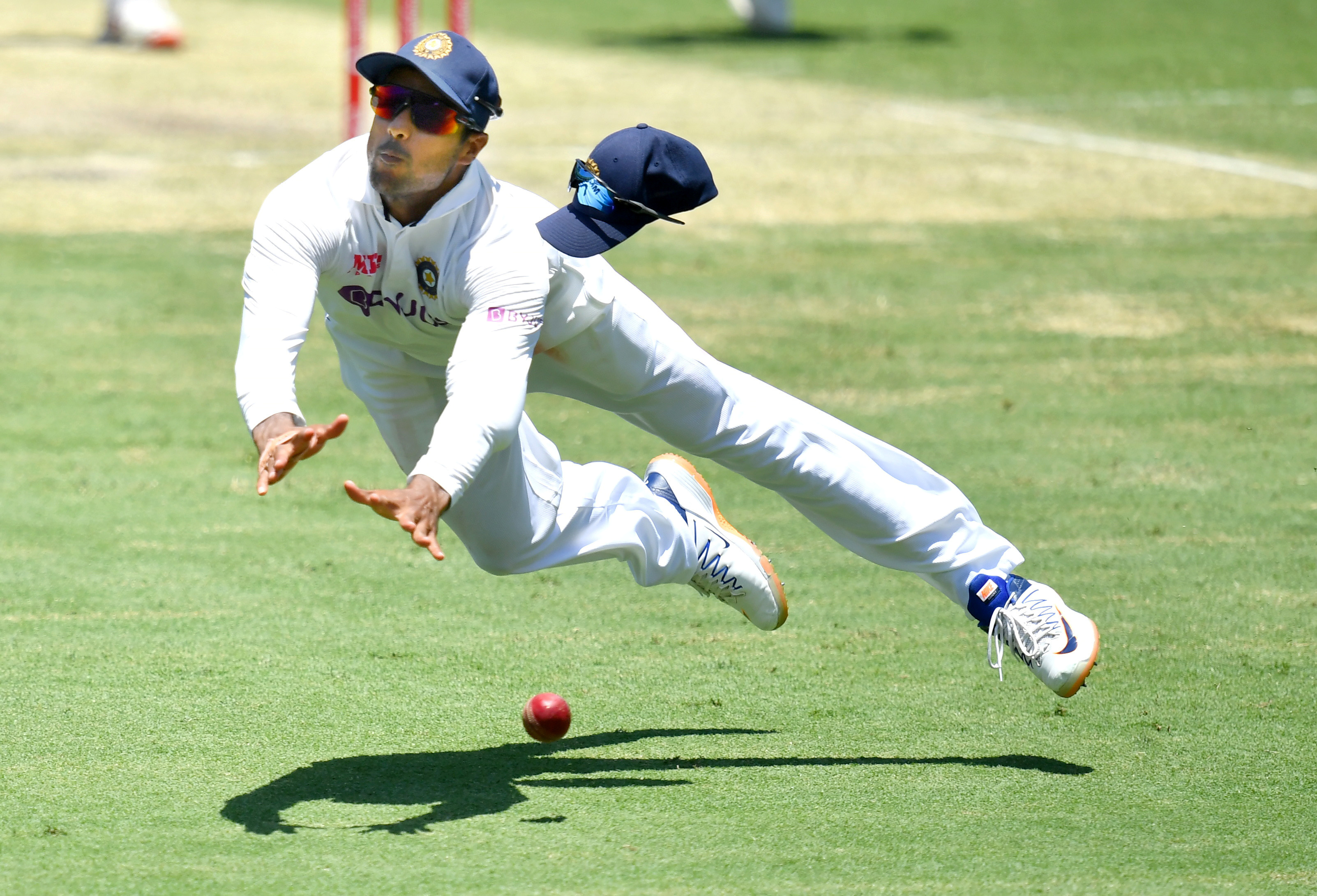 Mayank Agarwal of India drops a catch off the batting of Mitchell Starc of Australia during day two of the fourth test match between Australia and India at the Gabba in Brisbane, Australia, January 16, 2021. AAP Image/Darren England via REUTERS  ATTENTION EDITORS - THIS IMAGE WAS PROVIDED BY A THIRD PARTY. NO RESALES. NO ARCHIVE. AUSTRALIA OUT. NEW ZEALAND OUT     TPX IMAGES OF THE DAY