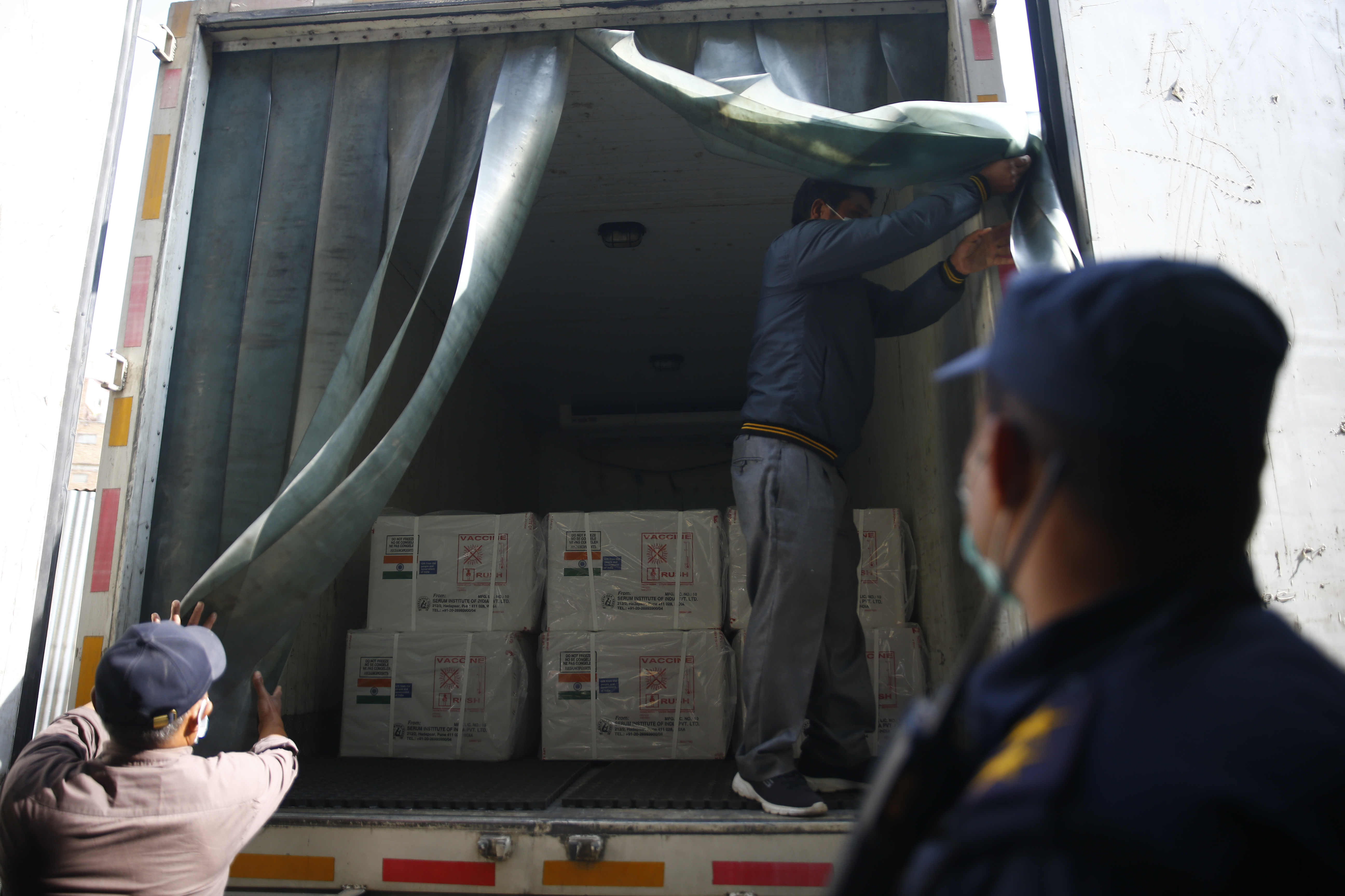 Hospital staffers unload Covid-19 vaccines that arrived from India at Department of Health Services, in Kathmandu, on Thursday, January 21, 2021. India under the u2018Vaccine Maitri' initiative is providing 1 million doses the vaccine, in aid, to Nepal to fight against the coronavirus. n Photo: Skanda Gautam/THT