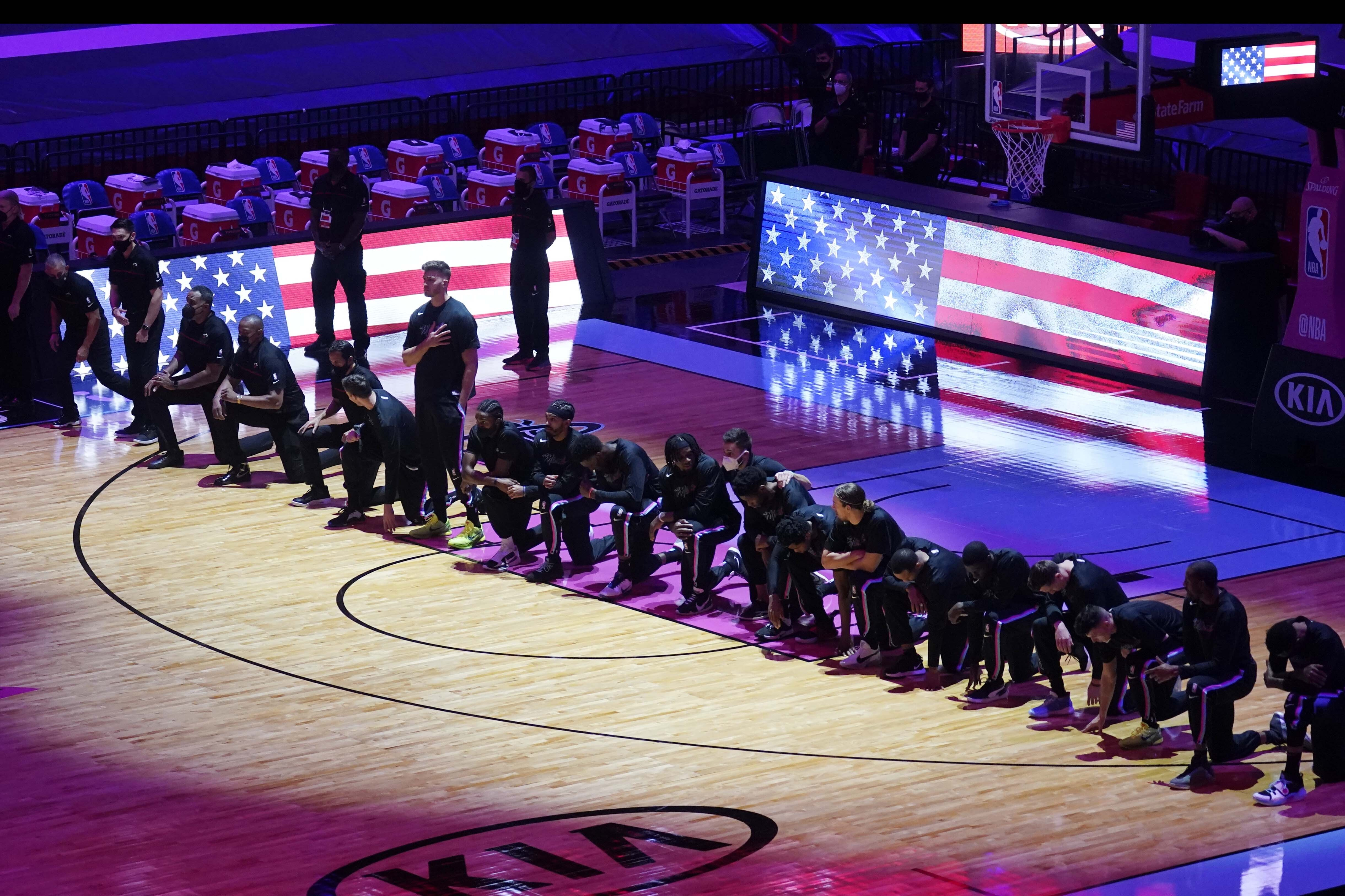 The Boston Celtics team kneels during the playing of the National Anthem before the first half of an NBA basketball game against the Miami Heat, Wednesday, Jan. 6, 2021, in Miami. Photo: AP