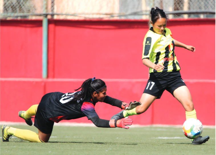 TAFCu0092s Bhujanga Rai dribbles the ball past Waling Municipality goalkeeper Sabitri Kisan during their National Womenu0092s League match in Lalitpur on Sunday. Photo: THT