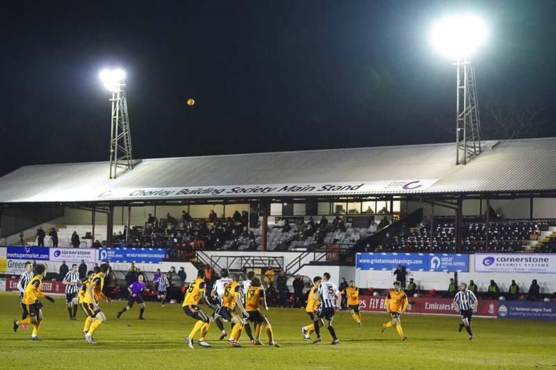 Players in action during the Emirates FA Cup fourth round soccer match between Chorley and Wolverhampton Wanderers at Victory Park in Chorley, England, on Friday, January 22, 2021. Photo: AP