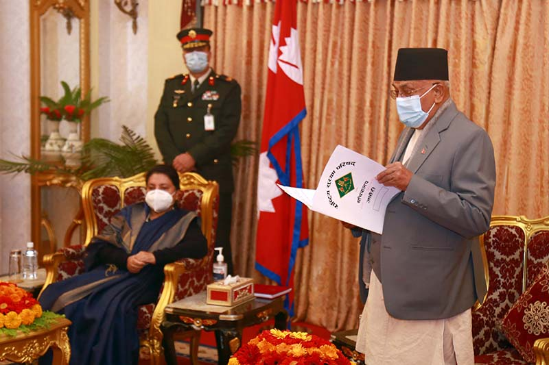 Prime Minister KP Sharma Oli presents the government's annual report for fiscal year 2019/20 to President Bidya Devi Bhandari at the latter's official residence in Shital Niwas, Kathmandu, on Thursday, January 7, 2021. Photo: RSS