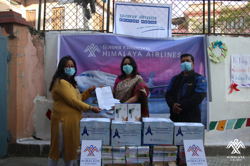 Ujjwala Dali, Head of Department u2013 Brand and Service Improvement, Himalaya Airlines handing over the yearlong educational supply and Covi-19 essentials to Mani Joshi, President of Prayas Nepal at the premise of the the organisation on December 31, 2020. Photo Courtesy: Himalaya Airlines