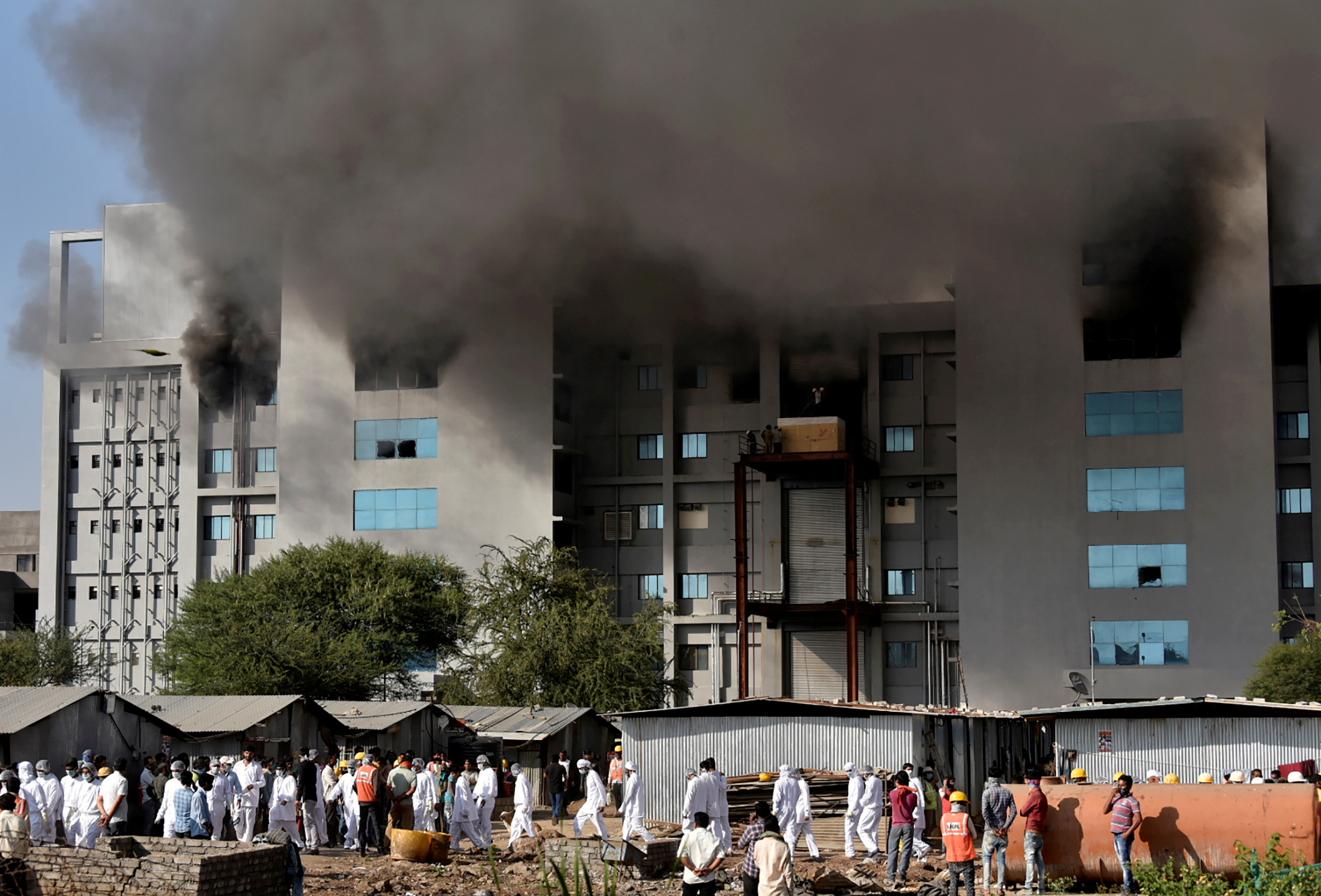 Smoke billows after a fire broke out inside the complex of the Serum Institute of India, in Pune, India, January 21, 2021. Photo: Reuters