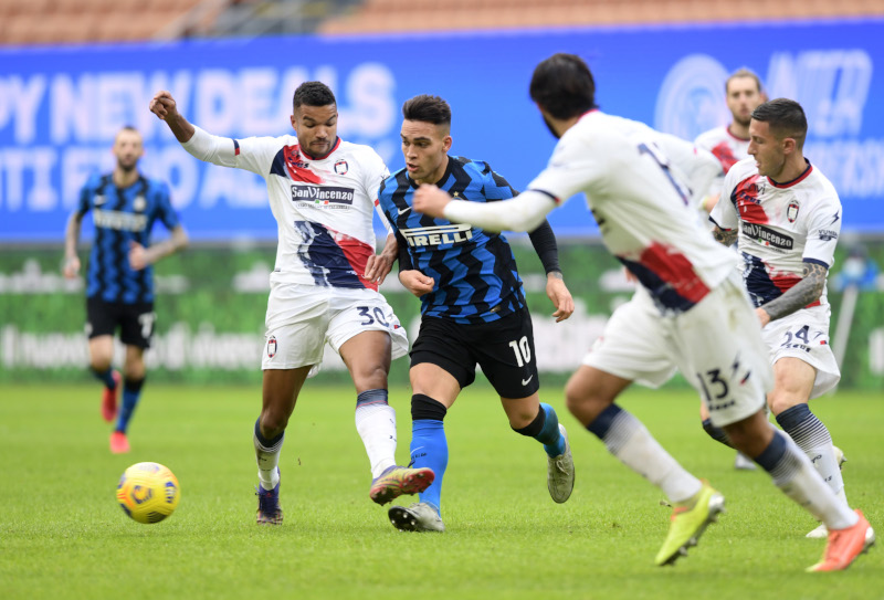 Inter Milan's Lautaro Martinez in action with Crotone's Junior Messias during the Serie A match between Inter Milan and Crotone, at San Siro, in Milan, Italy, on January 3, 2021. Photo: Reuters