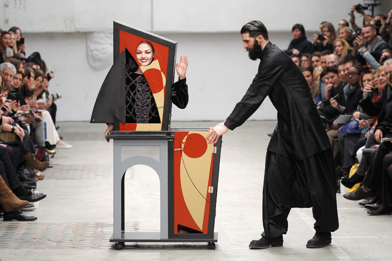 A magician performs with a model who presents a creation by Indian designer Manish Arora as part of his Fall-Winter 2011/2012 women's ready-to-wear fashion collection during Paris Fashion Week March 3, 2011.  Photo: Reuters/File