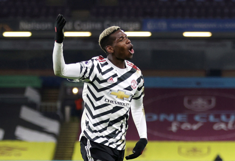 Manchester United's Paul Pogba celebrates scoring their first goal during the Premier League match at  Burnley and Manchester United, at Turf Moor, in Burnley, Britain, on January 12, 2021 Photo: Pool via Reuters