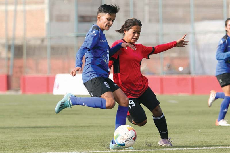 Nepal Police Clubu2019s Rekha Poudel and Chaudandigadhi Municipalityu2019s Manita Tamang (right) vie for the ball during their Womenu2019s National League in Lalitpur match on Friday, January 22, 2021. Photo: THT